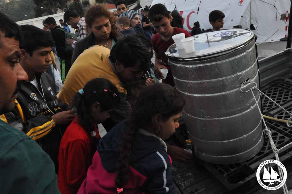 refugee kids drinking water